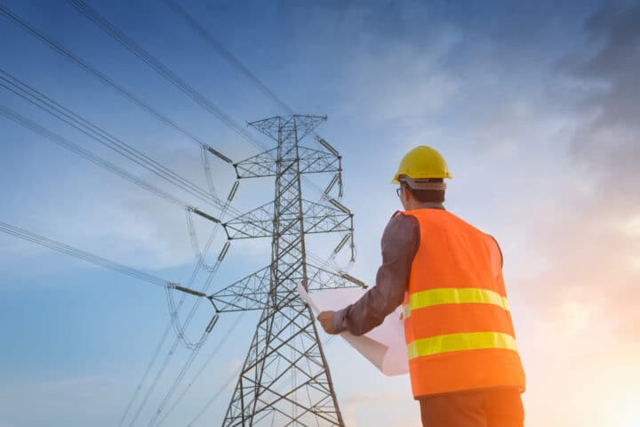 Engineering working on high voltage tower